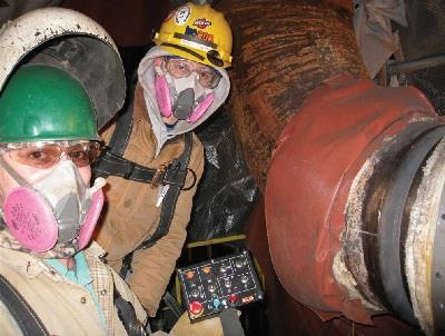 Fig. 1 — Operators use a remote control to operate the welding carriage.