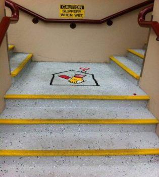 Speckled anti slip coated surface and stairs with logo